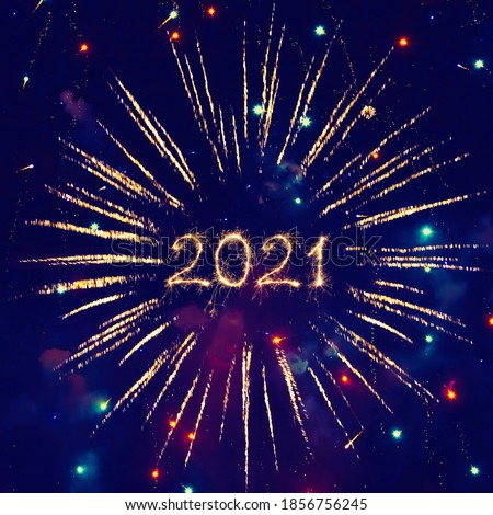 Happy New Year 2021. Beautiful creative Square holiday web banner or billboard with Golden sparkling Year 2021 written sparklers on festive blue background. #1856756245