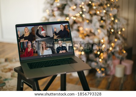 Virtual Christmas tree meeting team teleworking. Family video call remote conference. Laptop webcam screen view. Team meet working from their home offices. Happy hour party online woman team diversity #1856793328