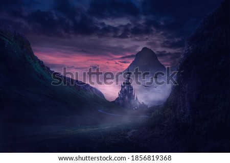 a castle in a mountain valley at sunset with a medieval atmosphere Royalty-Free Stock Photo #1856819368