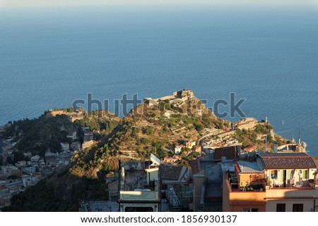 Castelmola, Sicily, Italy - August 27, 2020: Panorama of the Swabian castle of Taormina on Monte Tauro at sun Royalty-Free Stock Photo #1856930137