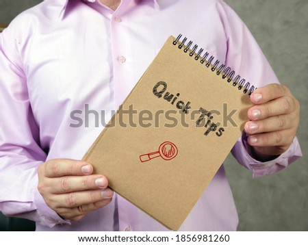 Financial concept meaning Quick Tips k with sign on the piece of paper.