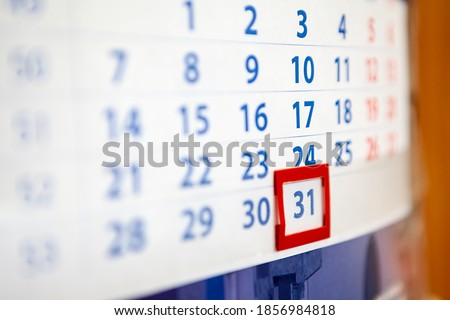 The December, 31, 2020, paper calendar with red frame for date, close-up view Royalty-Free Stock Photo #1856984818