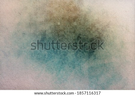 Subtle grunge shabby historic old wall background with stains in faded brown, blue, white colors Royalty-Free Stock Photo #1857116317