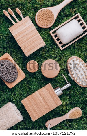 Zero waste, plastic free, sustainable concept. Bamboo bath accessories - soap dish, soap dispenser, tooth brush, organic dry shampoo for personal hygiene on green moss texture. Copy space. Top view Royalty-Free Stock Photo #1857121792