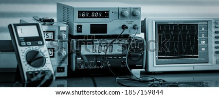 Development of electronic devices in the modern electronics laboratory, on a table, microprocessor oscilloscope and multimeter Royalty-Free Stock Photo #1857159844