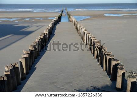 Breakwaters along the Zeeland coast near the town of Domburg Royalty-Free Stock Photo #1857226336