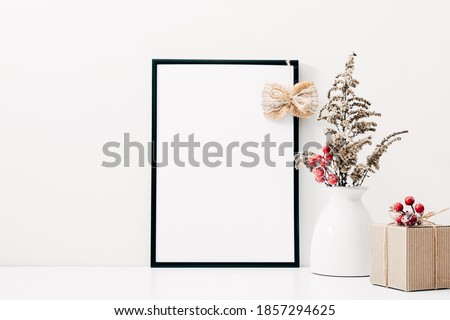 Christmas holiday composition. Xmas decorations. Photo frame on white background. Christmas, New Year, winter concept. front view