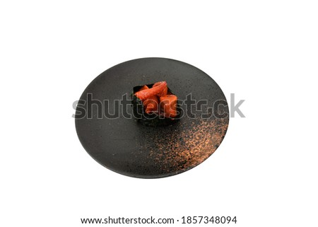 Top view of Spicy Octopus Gunkan Sushi with ceramic black plate, isolated on white background. Simply use for Japanese restaurant as sushi menu