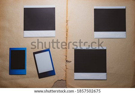 Blank photo frames on book background as template. Top View of photo frame, memory of a trip or adventure. Photo card with space for your logo or text.