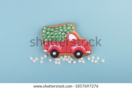 gingerbread truck carries a Christmas tree. holiday gingerbread cookies