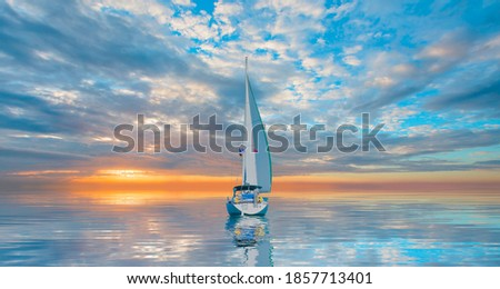 Sailing Yacht from sail regatta on mediterranean sea at sunset - Sailing luxury yacht with white sails in the Sea. Royalty-Free Stock Photo #1857713401