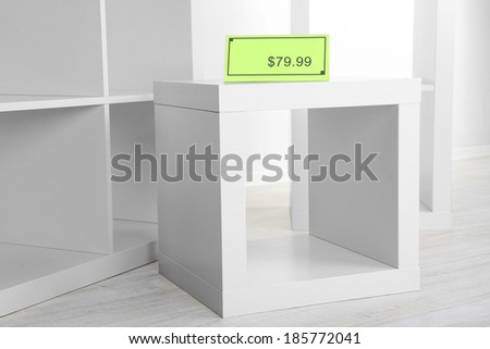 New white shelves with price on light background #185772041