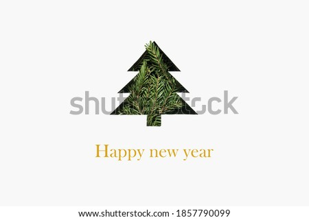 silhouette of a Christmas tree with green fir branches. Greeting card with a Christmas tree on a white background. up-to-date new year greeting card. Silhouette of a fir tree. Happy new year