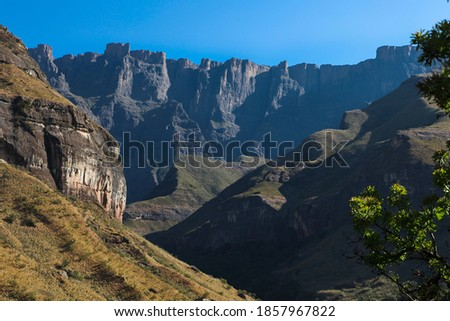 Amphitheatre Mountian in the Royal Natal National Park with blue sky. Royalty-Free Stock Photo #1857967822