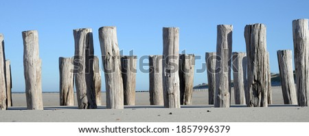 Breakwaters along the Zeeland coast near the town of Domburg Royalty-Free Stock Photo #1857996379