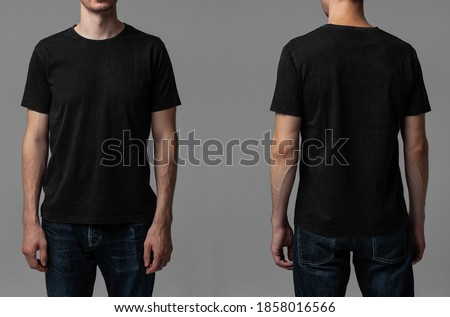 Young male in blank black t-shirt, front and back view. Design men t shirt template and mock-up for branding or print.  Royalty-Free Stock Photo #1858016566