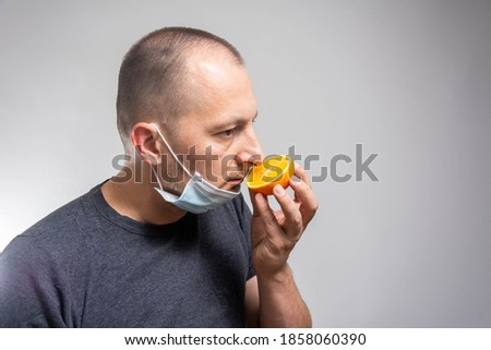 Anosmia or smell blindness, loss of the ability to smell, one of the possible symptoms of covid-19, infectious disease caused by corona virus. Royalty-Free Stock Photo #1858060390