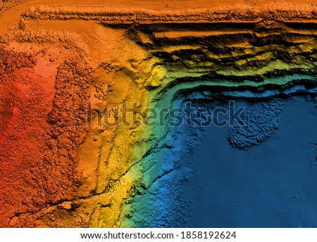 Model of a mine elevation. GIS product made after processing aerial pictures taken from a drone. It shows excavation site with steep rock walls Royalty-Free Stock Photo #1858192624