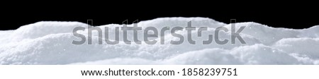 Banner of sparkling fuffy white snow hills isolated on black Royalty-Free Stock Photo #1858239751