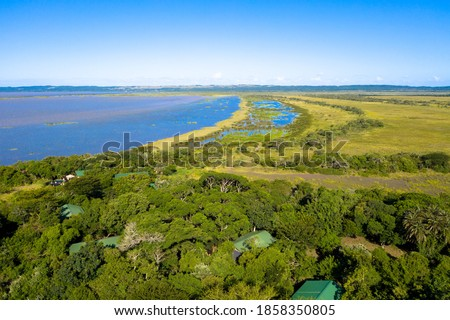 Drone view: Aerial view of iSimangaliso Wetland Park. Maputaland, an area of KwaZulu-Natal on the east coast of South Africa.  Royalty-Free Stock Photo #1858350805