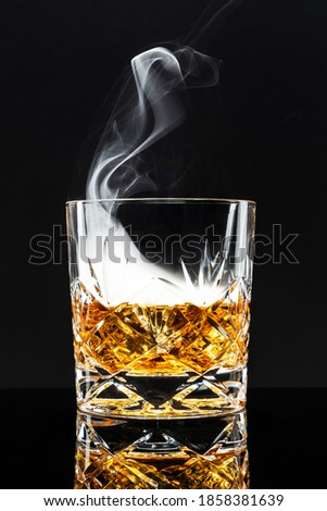Smoked whisky cocktail on black background