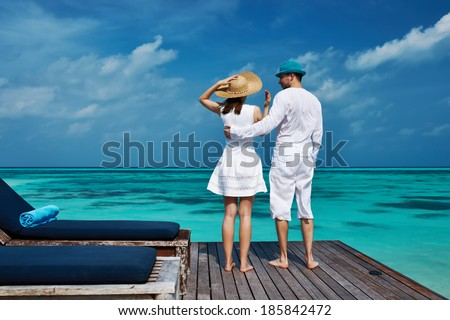 Couple on a tropical beach jetty at Maldives #185842472