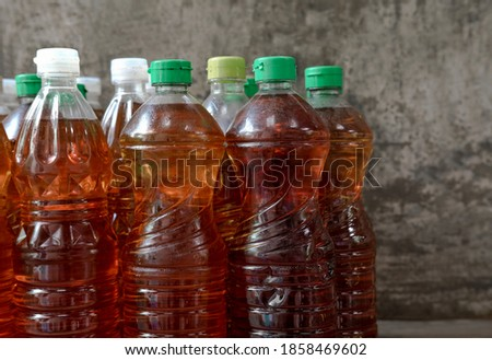 Used vegetable oil in bottle. Royalty-Free Stock Photo #1858469602