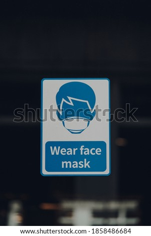 Close up of a Wear Face Mask sign outside a shop in London, UK. Copy space.