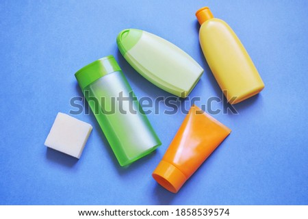 Natural soap, shower gel, shampoo, moisturizing body lotion. Skin care products, toiletries set, personal care. Flat lay beauty photography Royalty-Free Stock Photo #1858539574