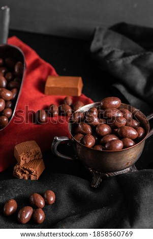 Chocolate covered peanuts for backgrounds #1858560769