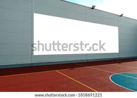Mock up. Blank white billboard outdoors, outdoor advertising, public information board on the wall near sport ground