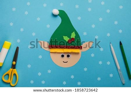 Children's winter craft paper Elf. Children's art project. DIY concept. Easy craft for kids