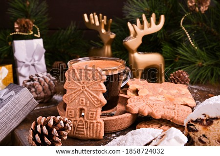 Festive decor, Speculaas koekjes and espresso for st. Nicolas . Dutch holiday Sinterklaas traditional sweets gingerbread cookies. 5th December holiday in the Netherlands.  Royalty-Free Stock Photo #1858724032