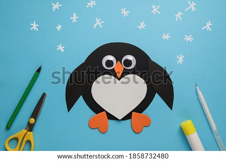 Children's winter craft Penguin made of paper. Children's art project. DIY concept. Easy craft for kids