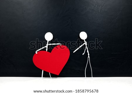 Stick man holding big red heart shape while giving to other people. Share love and kindness, give hope, helping others concept.