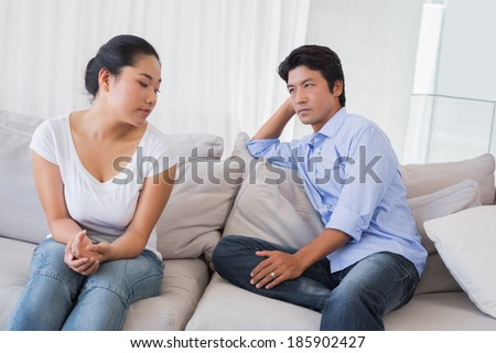 Couple not talking after a dispute on the sofa at home in the living room #185902427