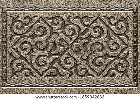Ornamental print on the stone surface. Vintage ornament on the stone. Close-up seamless texture. Stone texture. Pattern on the stone. Embossed pattern. Wallpaper. Royalty-Free Stock Photo #1859042833