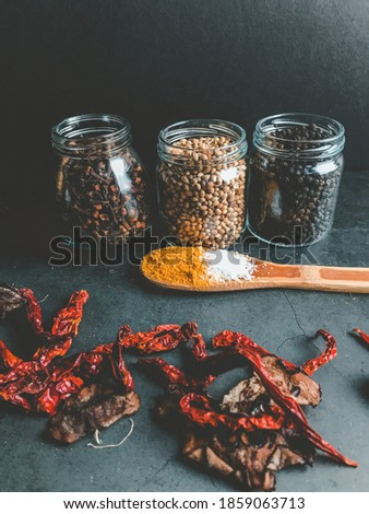 Spices and herbs on a black background. This picture is suitable for decoration in the kitchen and others.