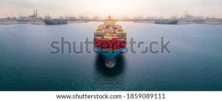 Aerial in front of cargo ship carrying container and running  near international custom depot sea port concept smart logistic service. Royalty-Free Stock Photo #1859089111