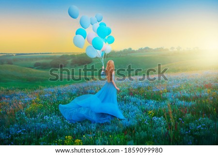 Artwork. Silhouette in motion happy woman. Fantasy girl princess holding in hand ball air balloon. long blue dress fluttering fly in wind. Sunset sky fog, flowers green meadow. blond hair back view