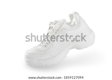 White sneaker. One White sneaker isolated on white background. simulation of the walking process. in motion. sport shoe concept