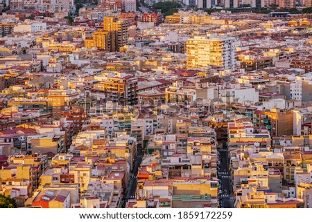 Urban pattern of a Mediterranean city. Residential district. Narrow streets. Alicante, Spain. Royalty-Free Stock Photo #1859172259