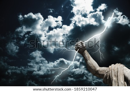 Mighty god Zeus. The power of king of Olympic gods is the ability to throw lightning bolts. Fragment of an ancient statue. Royalty-Free Stock Photo #1859210047