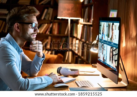 Business man meeting virtual team on video conference call using computer. Social distance worker working from home office in remote videoconference online chat, watching webinar, making videocall. Royalty-Free Stock Photo #1859215525