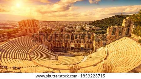 Odeon of Herodes Atticus at sunset, Athens, Greece. It is old famous landmark of Athens. Scenic panorama of ancient Greek monument overlooking Athens city. Sunny panoramic view of classical theater. Royalty-Free Stock Photo #1859223715