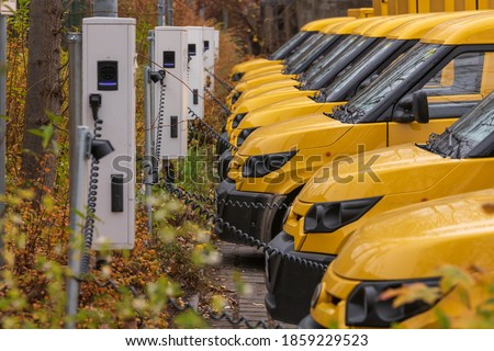 Yellow electric vehicles at the charging station Royalty-Free Stock Photo #1859229523