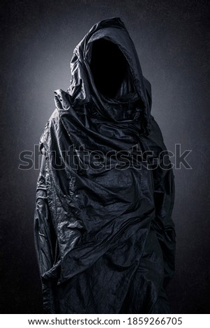 Ghostly figure in the dark Royalty-Free Stock Photo #1859266705