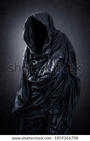 Ghostly figure in the dark Royalty-Free Stock Photo #1859266708