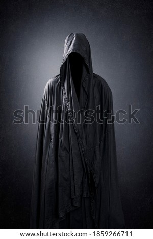 Ghostly figure in the dark Royalty-Free Stock Photo #1859266711