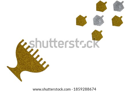 Golden glitter menorah and dreidel spinning top isolated on white. Image of Jewish holiday Hanukkah.